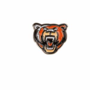 Das Bild zeigt einen Ansteckpin der Grizzlys Wolfsburg mit Grizzly-Kopf.